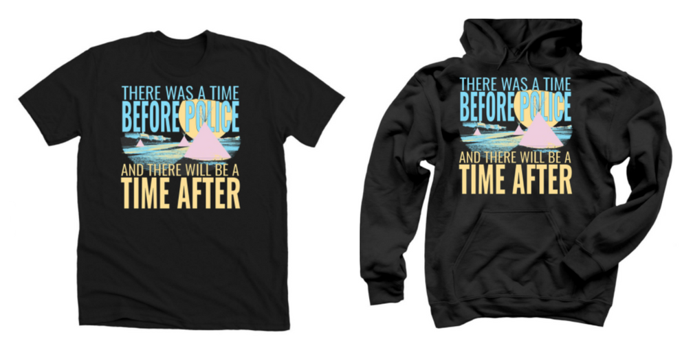 """A black t-shirt and hoodie, both with the same design printed onto them. An image of tipis on a plain, with the text """"There was a time before police and there will be a time after."""""""